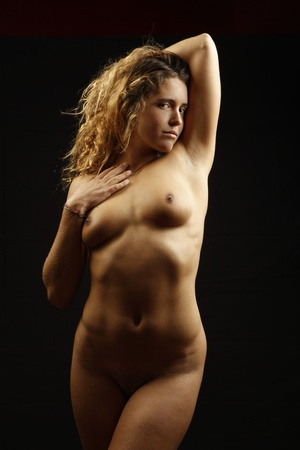 portrait of beautiful nude young girl on black background Stock Photo - 9843833
