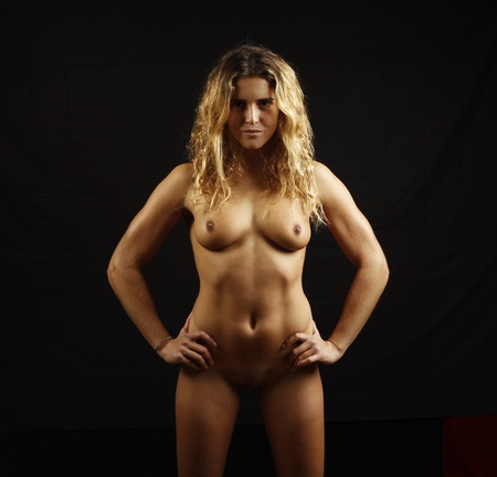 naked girl black hair: portrait of beautiful nude young girl on black background Stock Photo