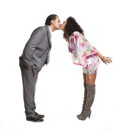 confident elegant couple of young people kissing