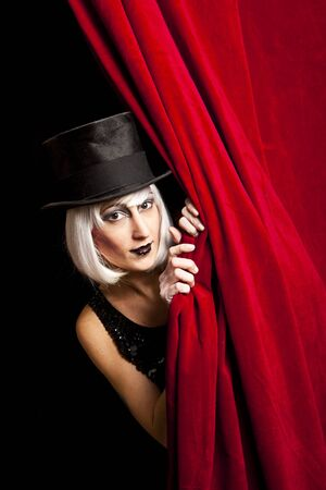 performers: cabaret performer on stage looking at the audience Stock Photo