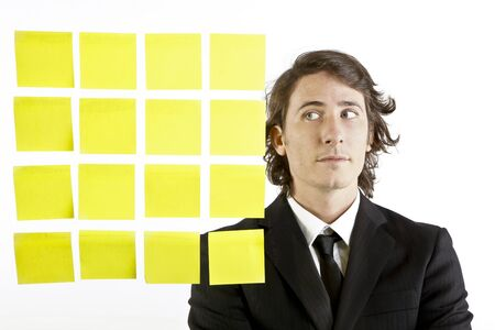 young businessman looking at postit reminder notes Stock Photo - 9844226