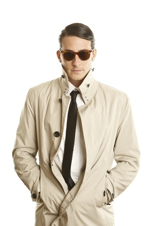 fashion young man with sunglasses and trenchcoat