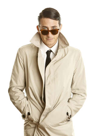 fashion young man with sunglasses and trenchcoat photo