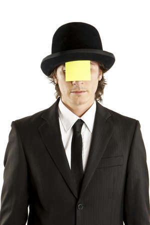 man with blank note on the face with hat photo