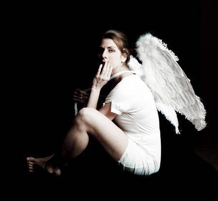 blonde angel against black background photo