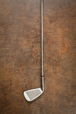 grungy isolated: golf club on wooden background
