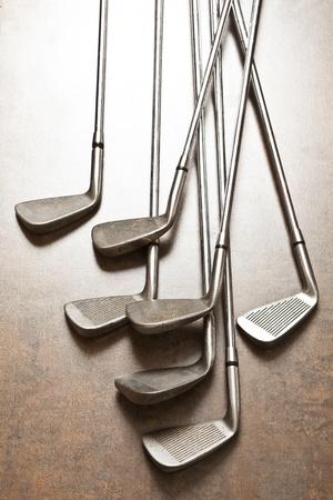 golf club on wooden background photo
