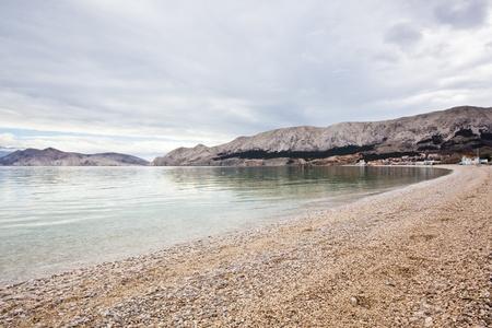 quite: quite cloudy beach in croatia, baska