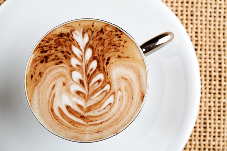 art latte on a cappuccino coffe cup photo