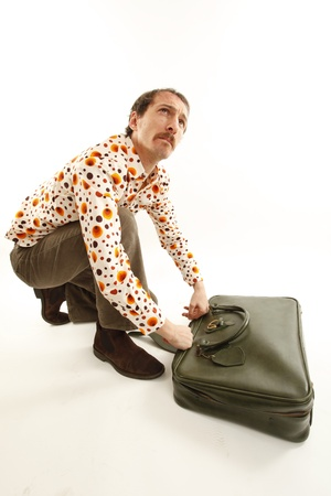 funny vintage young man with suitcase photo