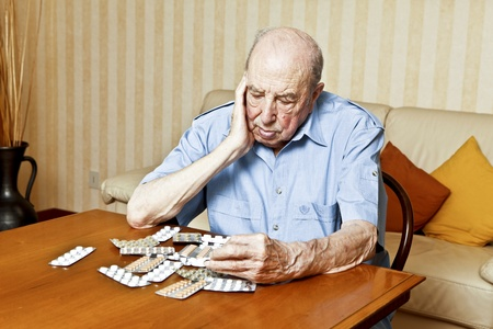 elder man with pills Stock Photo