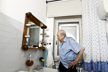 portrait of elder man in the bathroom Stock Photo