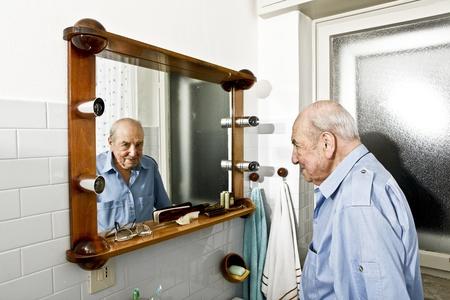 portrait of elder man in the bathroom photo