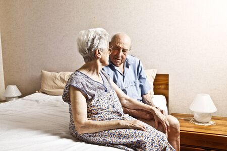 elderly couple in the bedroom