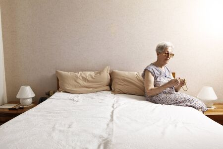 old lady in the bedroom photo
