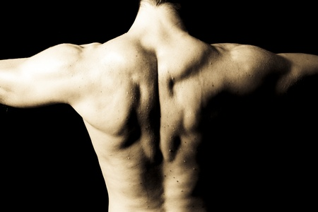 creative strength: Man with big muscular back on black background