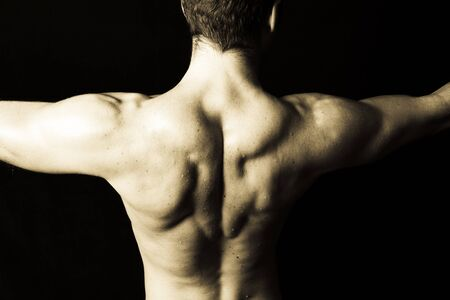Man with big muscular back on black background Stock Photo - 9985300