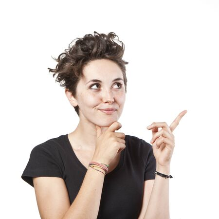 portrait of a happy young beautiful woman pointing at something interesting against white background Stock Photo - 10875915