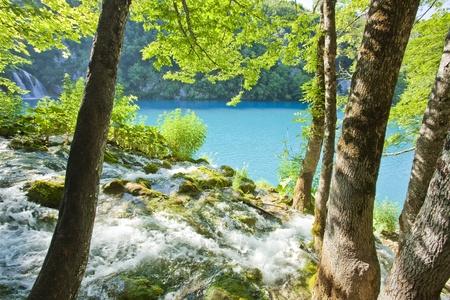 plitvice: Waterfalls in national park falling into turquoise lake. Plitvice, Croatia
