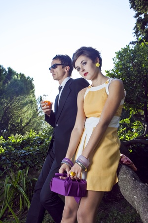 60s: fashion portrait of retro sixties style young couple Stock Photo