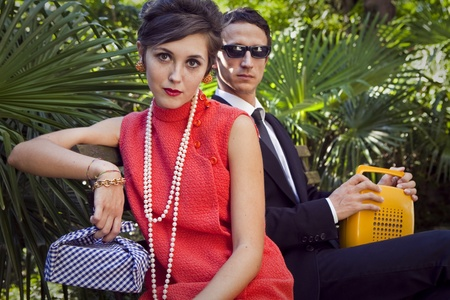 60s adult: fashion portrait of retro sixties style young couple Stock Photo