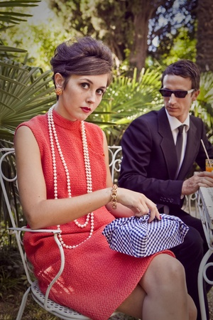 60s fashion: retro sixties style fashion couple having breakfast outdoor Stock Photo