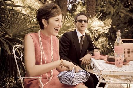 60s adult: retro sixties style fashion couple having breakfast outdoor Stock Photo