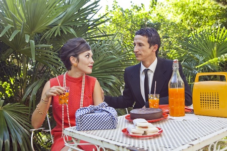 retro sixties style fashion couple having breakfast outdoor photo