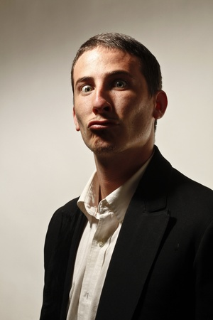 young businessman face expression photo