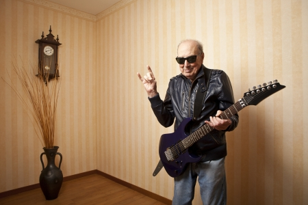 cool fashion elder man with electric guitar Stock fotó