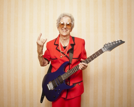 cool fashion elder lady with electric guitar photo