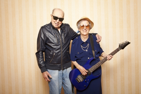 cool fashion elder couple with electric guitar photo
