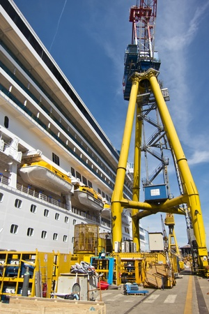 cruise ship under constrruction in a shipyard photo
