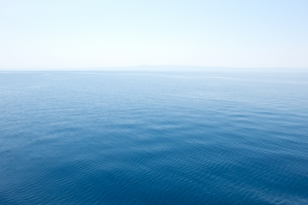 still water: clear blue sea, water seascape abstract background