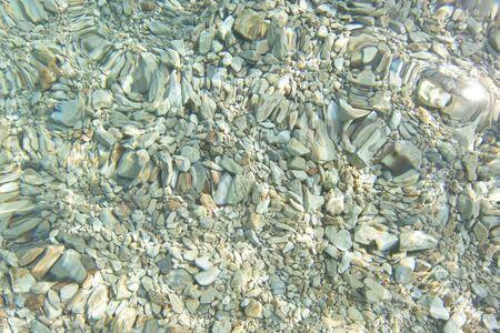 rocky sea floor, clear water, croatia photo