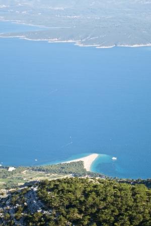 aerial view of zlatni rat, famous beach in brac, croatia photo