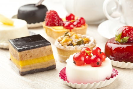 cakes and pastries: Different sort of beautiful pastry, small colorful sweet cakes Stock Photo
