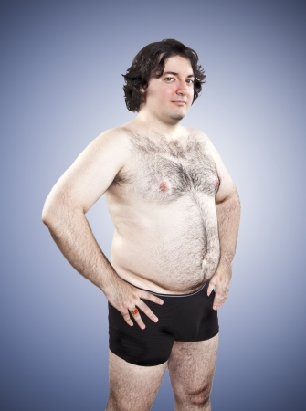 fat proud young man on blue background Stock Photo