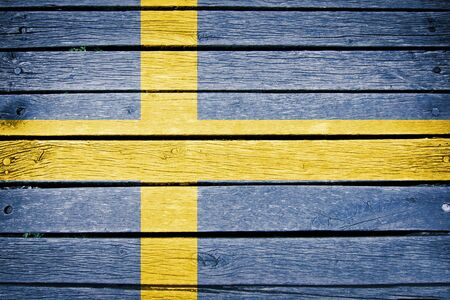 sweden flag: sweden, swedish flag painted on old wood plank background
