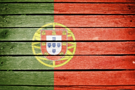 portuguese, portugal flag painted on old wood plank background photo