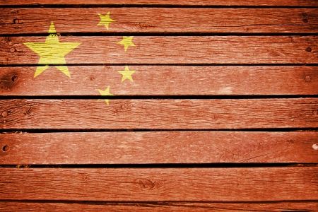 china, chinese  flag painted on old wood plank background photo