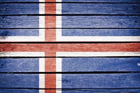 the icelandic flag: iceland, icelandic flag painted on old wood plank background