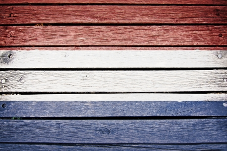 wood texture background: Netherlands dutch flag painted on old wood plank background