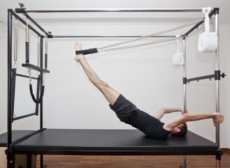 man practicing pilates Stock Photo