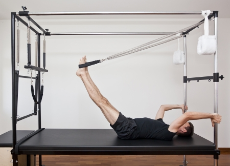 man practicing pilates photo