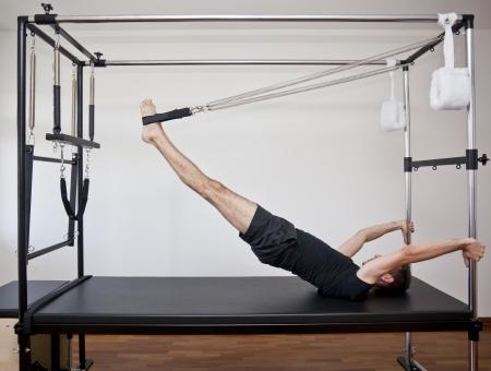 man practicing pilates photo