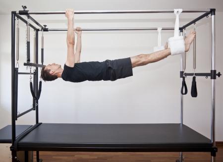 man practicing pilates Standard-Bild