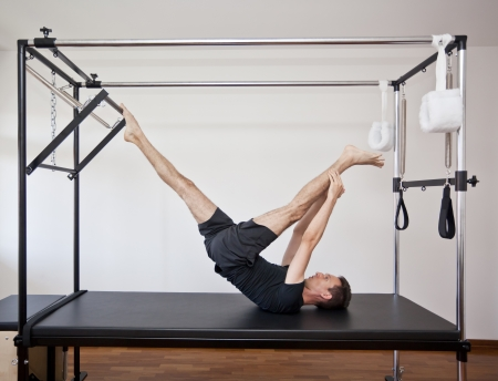 man practicing pilates Stock Photo