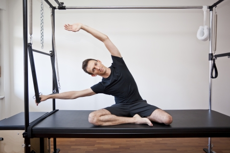 man practicing pilates Stockfoto