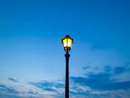 street lamp on evening sky background photo